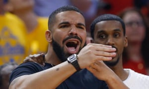 Drake courtside, wearing his saucy watch, watching Toronto Raptors v Golden State Warriors.