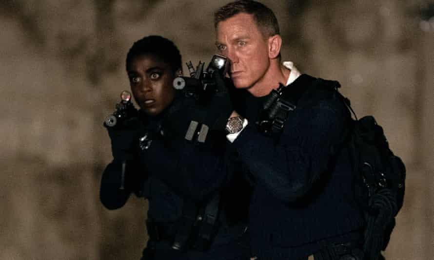 By the end, they are a team … Lashana Lynch and Daniel Craig in No Time to Die.