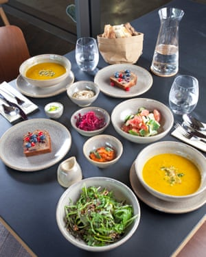 Lunch With Olafur Eliasson at the Tate Modern terrace bar, for OFM, London, 10/07/2019. Sophia Evans for The Observer Spiced carrot soup, courgette salt with pink grapefruit, green salad, pickled beetroot (house ferment), breads, labneh (small pot with chopped chives), roasted red pepper dip, hummus, courgette cake with berries and double cream