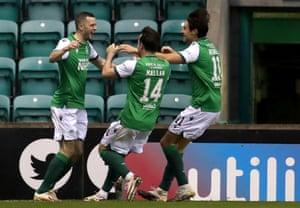 Hibernian's Stephen Mallan (centre) and Joe Newell rush to congratulate Jamie Murphy (left) after he opened the scoring.