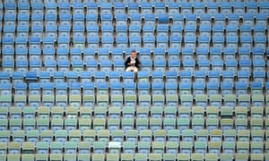 A fan waits for the start of Australia's match against Germany in Sochi.