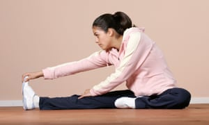 Woman in gym clothes doing pilates exercise