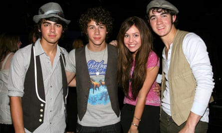 Jonas Brothers with Miley Cyrus, 2007.