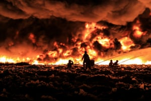 Firefighters tackle a blaze at a Birmingham plastics recycling plant in 2013.