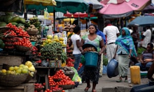 Women sell vegetables and other food in a market in Lagos, Nigeria.