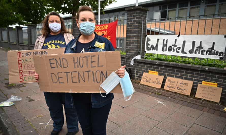 Anti-racism protesters in Glasgow call for an end to the detention of asylum seekers in hotels in July.