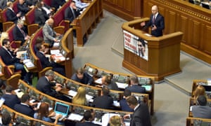 Ukrainian prime minister Arseniy Yatsenyuk addressing parliament on Tuesday, where he survived a vote of no-confidence