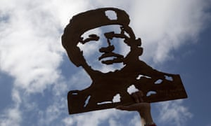 An image of Venezuela's late president Hugo Chávez is raised aloft by supporters of president Nicolás Maduro.