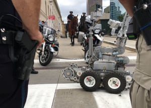 Police officers in Cleveland, Ohio, demonstrate some of their security assets.