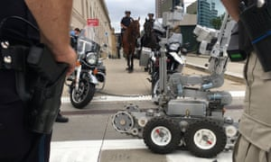 Police officers in Cleveland, Ohio, demonstrate some of their security assets, including remote-controlled robots, horse-mounted officers, bomb-sniffing dogs ahead of the Republican national convention.