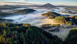 Widescreen shot of the Bohemian Switzerland national park wreathed in mist, in the Czech Republic.