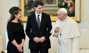 Pope Francis speaks with Justin Trudeau and his wife, Sophie Gregoire-Trudeau.