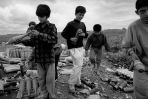 Children in Kirkuk, three of whom were killed the day after the photograph was taken, after they put one of the bombs they had collected in a fire