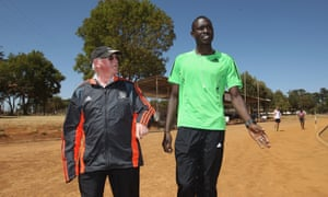 David Rudisha with his coach, Brother Colm O'Connell.