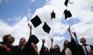 Students throw their caps in the air ahead of their graduation ceremony at the Royal Festival Hall in 2014 in London.