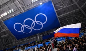 A spectator waves the Russian flag during the ice hockey match between the Olympic Athletes from Russia and Slovenia at Pyeongchang 2018.