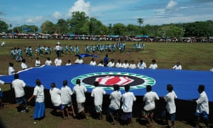 Bougainville school children display a giant flag of Bougainville