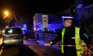 Police secure a scene of a fire in Koszalin where five 15-year-old girls were killed.
