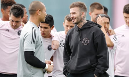 Inter Miami co-owner David Beckham talks with goalkeeper Luis Robles during a training session in February