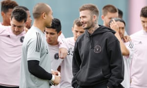 David Beckham talks with Luis Robles after the goalkeeper was named as Inter Miami's captain