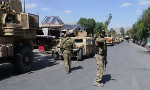 Afghan security forces on patrol in Farah city in May, after recapturing it from the Taliban.