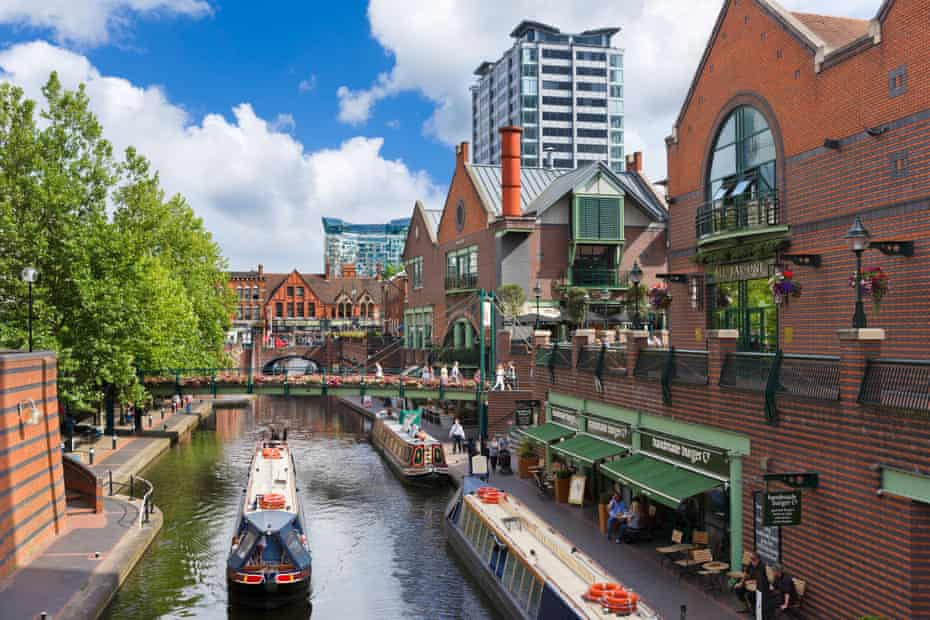Narrowboats in front of restaurants on the canal at Brindleyplace, Birmingham.