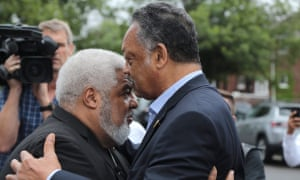The Rev Jesse Jackson and the Rev Robert Smith Jr speak outside New Bethel Baptist church on 16 August.