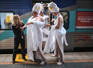 Drag queens board a train in Sydney, Australia