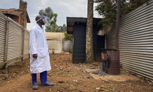 A medical worker checks the quarantine area of the Matanda Hospital in Butembo, where the first case of Ebola died, in the North Kivu province of Congo.