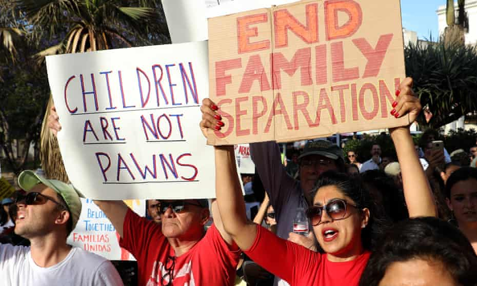 Protesters denounce the Trump administration's policy of separating detained immigrant children from their parents, at a rally and march in Los Angeles, California, 14 June 2018.