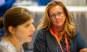 Guardian US deputy editor Jane Spencer talks with Indiana teacher Marci Cochoran and others at a teachers conference in July.