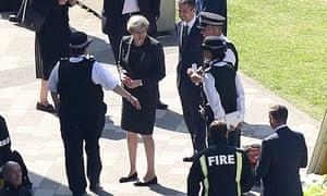 Theresa May visits Grenfell Tower