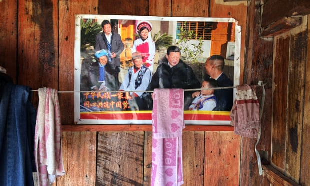 Posters of Xi Jinping have been plastered on nearly all new homes in Padangshang.