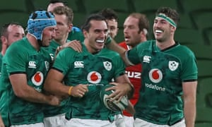 Ireland's wing James Lowe (centre) celebrates with teammates after scoring a late try.