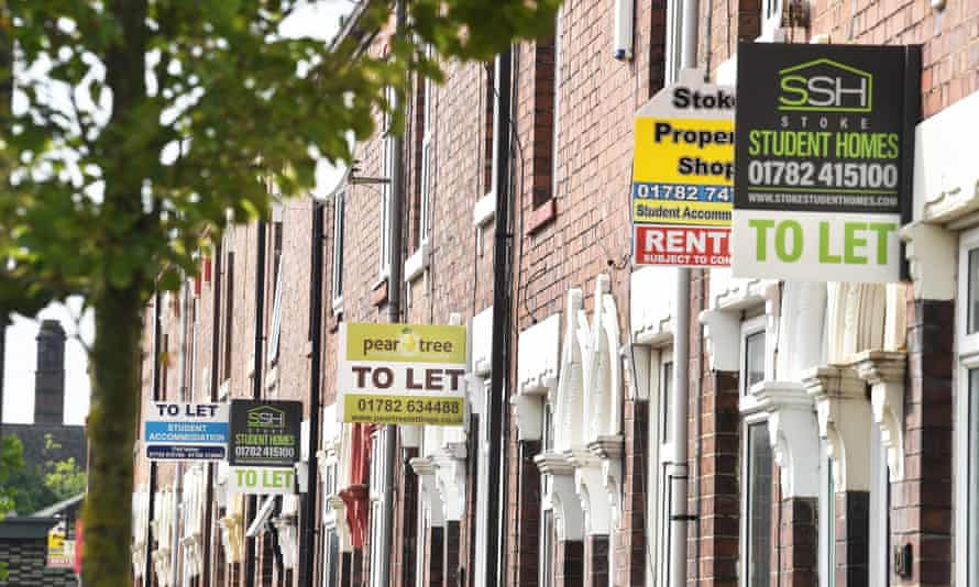 Various property signs are seen outside a block of terraced houses advertising homes for sale, let or sold