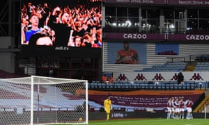 A recording of celebrating Villa fans plays on the big screen at Villa Park after Kortney Hause doubled their lead.