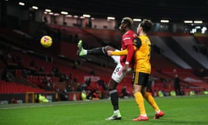 Paul Pogba of Manchester United and Rayan Ait-Nouri of Wolverhampton Wanderers.