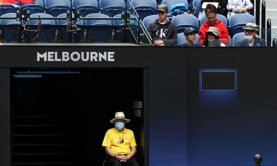 Melbourne staff and fans follow the action. Players who stayed at the Grand Hyatt are being told to isolate.
