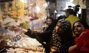 Shoppers look for jewellery ahead of the Eid al-Fitr festivities amid the pandemic in Karachi.