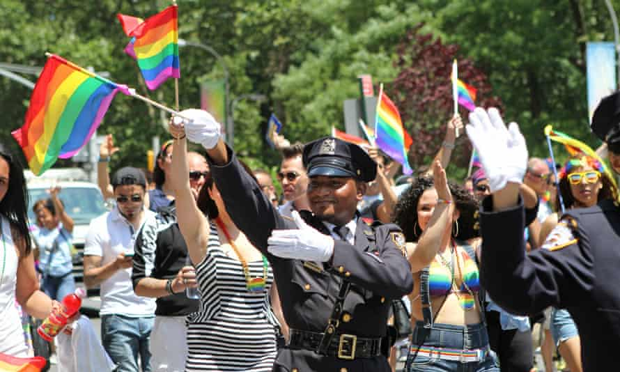 An NYPD officer takes part in the 2014 Pride march