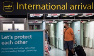 Passengers arrive at Gatwick Airport before Tuesday's 4am requirement for travellers arriving from Portugal to quarantine for 10 days comes into force.