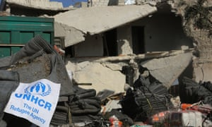 A UN flag lies next to a destroyed aid convoy outside Aleppo