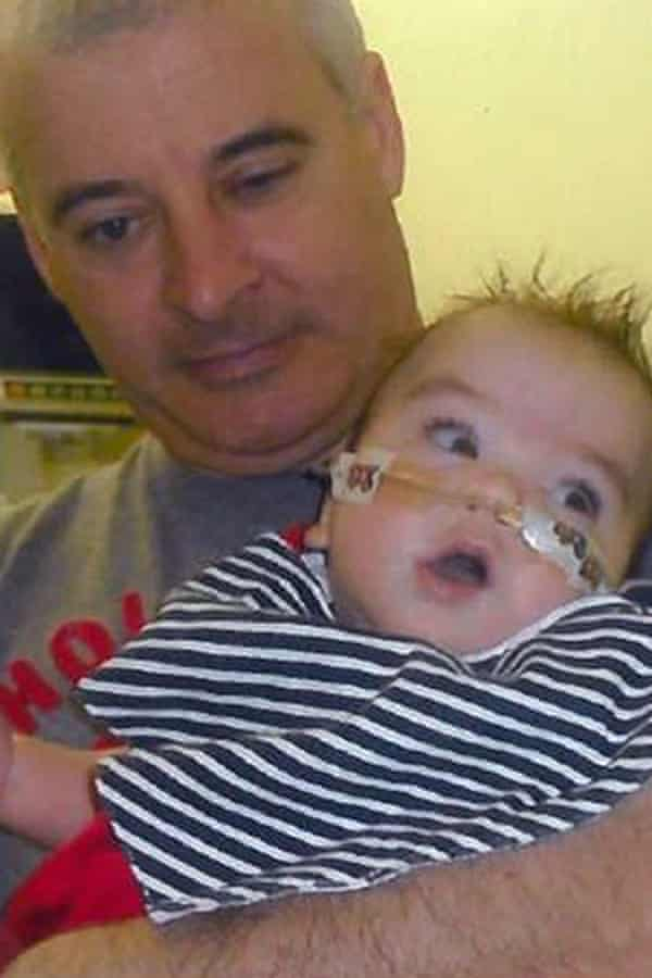 Kevin McGuigan with his grandson Ollie in hospital in 2011.