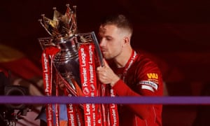 Jordan Henderson with the Premier League trophy on Wednesday.