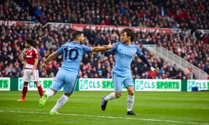 Manchester City's David Silva, right, is congratulated by Sergio Agüero after he opened the scoring.