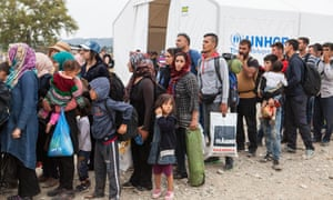 Refugees line up at the UNHCR registration centre in Gevgeliya, Macedonia