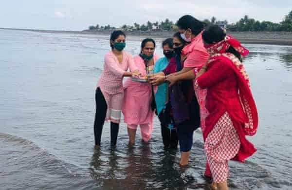 Volunteers from Anam Prem offer prayers to the ocean on the beach at Satpati , 80km north of Mumbai on World Oceans Day