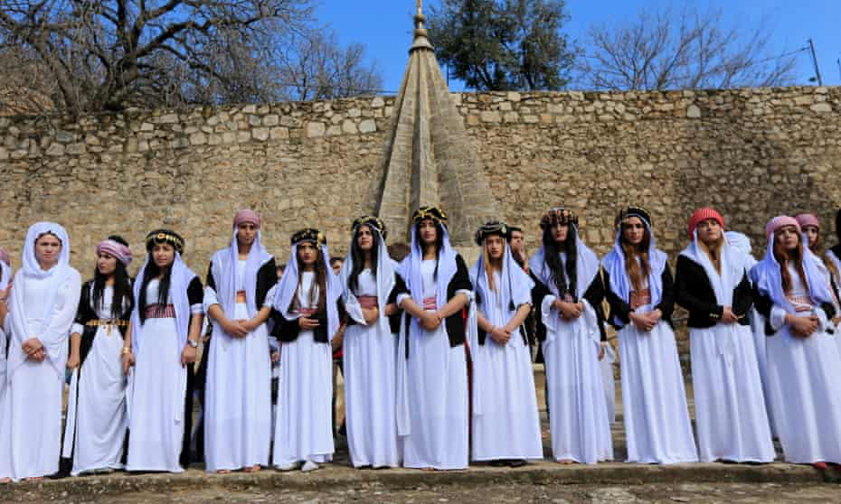 Yazidi women at a ceremony to commemorate the death of women killed by Islamic State in Iraq, March 2019