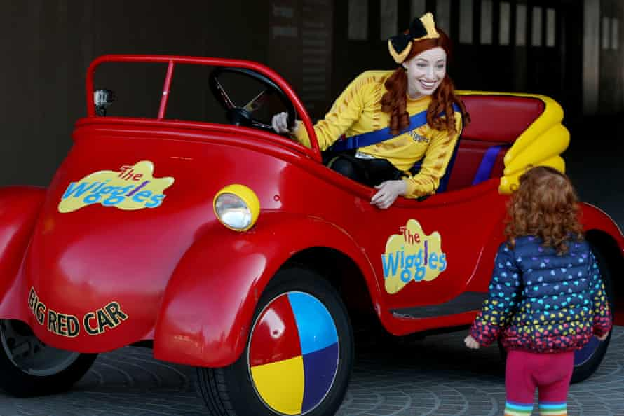 Fan-favourite Emma Watkins smiles at a young fan from the Big Red Car.