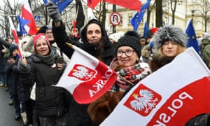 Anti-government protesters gather in front of Warsaw's Constitutional Court last month.